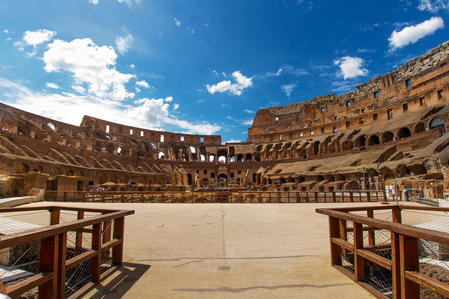 A look at the Roman Colesseum from the middle of the arena